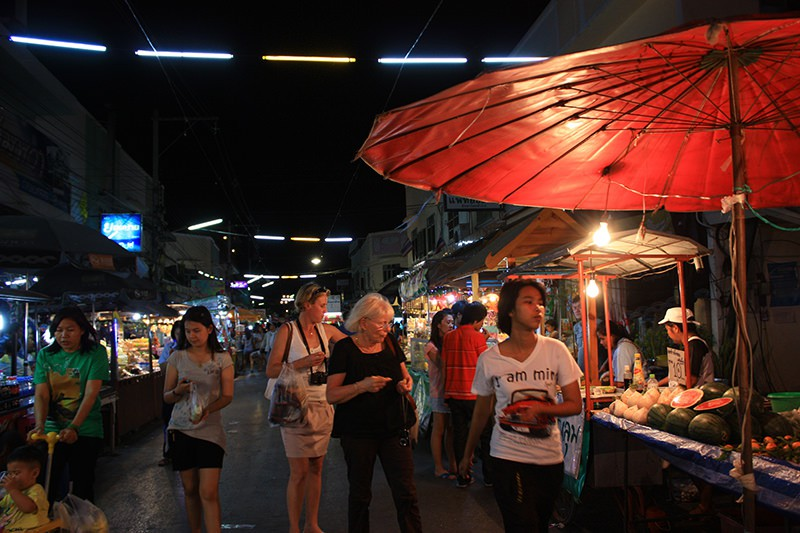 Fluorescent lamps are hang above the street as public light Thailand Bankok