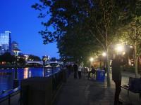 Glaring spotlights along the river