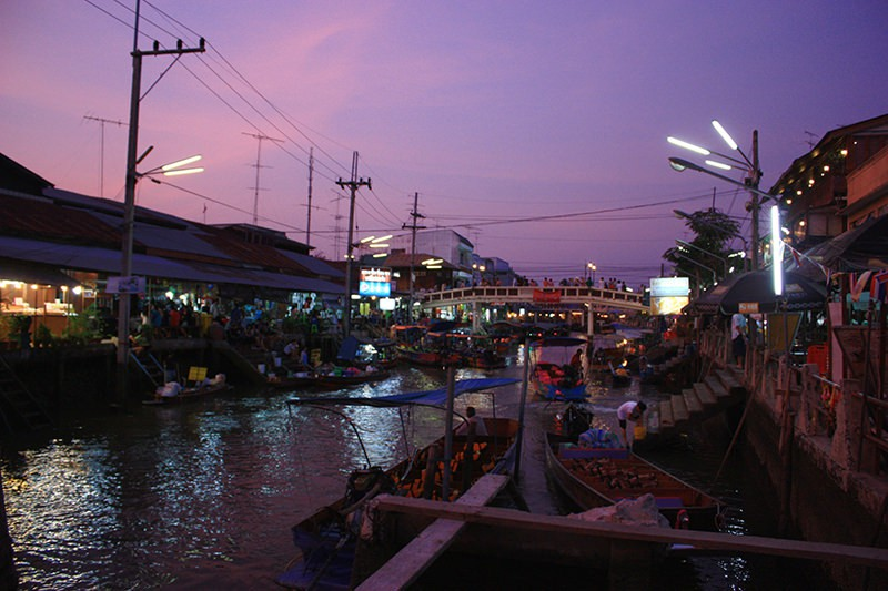 Reflections on the river of Amphawa floating market Thailand